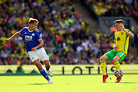 28th August 2021; Carrow Road, Norwich, Norfolk, England; Premier League football, Norwich versus Leicester; Marc Albrighton of Leicester City passes the ball round Billy Gilmour of Norwich City