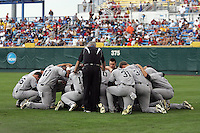 South Carolina team huddle before Game 3 of the NCAA Division One Men's College World Series on Sunday June 20th, 2010 at Johnny Rosenblatt Stadium in Omaha, Nebraska.  (Photo by AJ Woolley / Four Seam Images)