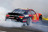 2017 NASCAR Xfinity Series<br /> My Bariatric Solutions 300<br /> Texas Motor Speedway, Fort Worth, TX USA<br /> Saturday 8 April 2017<br /> Erik Jones, Game Stop/ GAEMS Toyota Camry celebrates his win with a burnout <br /> World Copyright: Russell LaBounty/LAT Images<br /> ref: Digital Image 17TEX1rl_2581