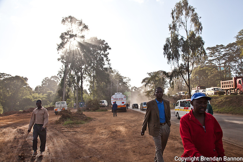 Pedestrians navigate  through   construction on Chiromo rd in Nairobi.
