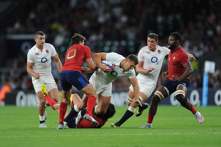Sam Burgess of England is tackled by Francois Trinh-Duc of France - 15/08/2015 - Twickenham Stadium - London <br /> Mandatory Credit: Rob Munro/Stewart Communications