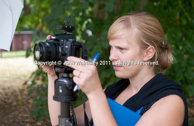 Vita Gortgens, ex-pupil, taking photos at the reunion for Summerhill School's 90th birthday celebrations.
