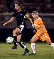 Washington Freedom forward (20) Abby Wamach tries to find some open space away from Sky Blue FC defender (4) Jen Buczkowski at the Maryland SoccerPlex in Boyds, Maryland.  The Washington Freedom defeated Sky Blue FC, 3-1, to secure a place in the playoffs.