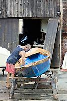 Un operaio al lavoro su una barca, allo Squero San Trovaso, Venezia.<br /> A worker at the Squero San Trovaso in Venice.<br /> UPDATE IMAGES PRESS/Riccardo De Luca
