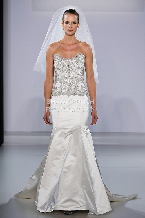 Model walks runway in bridal dress from the Eve Of Milady Fall 2013 Couture collection, by Eve Muscio during Couture New York Bridal Fashion Week, October 12, 2012.