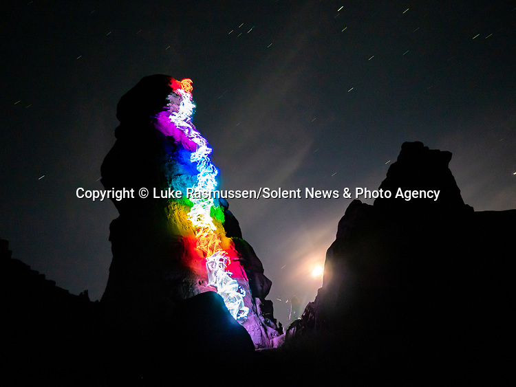 "Pictured:  A 1 minute 12 seconds exposure at Lizard Rock, Fisher Towers, Moab, UT<br /> <br /> Bright bolts of colourful light snake their way across mountains and cliffs.  The striking images were created by a rock climber who wrapped LED lights around his body before capturing long exposure shots of his route.<br /> <br /> Luke Rasmussen took the photos in the deserts of Nevada, in the United States, and admits that his method of 'freezing time in a moment' is unusual.  The 28 year old photographer said: ""Wearing a sweater full of lights and climbing through the darkness of night is certainly a different experience than most climbers will get.  SEE OUR COPY FOR DETAILS.<br /> <br /> Please byline: Luke Rasmussen/Solent News<br /> <br /> © Luke Rasmussen/Solent News & Photo Agency<br /> UK +44 (0) 2380 458800"