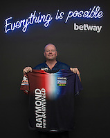20.05.2015. London,  England. Betway Premier League Darts, Play-Offs Media Day. [L-R] Reigning Betway Premier League Champion Raymond van Barneveld unveils his new shirt for the final at the O2 Arena.