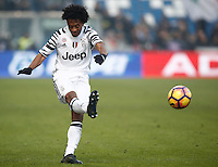 Calcio, Serie A: Sassuolo vs Juventus. Reggio Emilia, Mapei Stadium, 29 gennaio 2017. <br /> Juventus' Juan Cuadrado kicks the ball during the Italian Serie A football match between Sassuolo and Juventus at Reggio Emilia's Mapei stadium, 29 January 2017<br /> UPDATE IMAGES PRESS/Isabella Bonotto