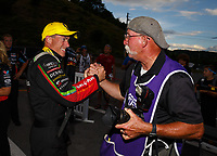 Jun 18, 2017; Bristol, TN, USA; NHRA top fuel driver Clay Millican (left) celebrates with photographer Roger Richards after winning the Thunder Valley Nationals at Bristol Dragway. Mandatory Credit: Mark J. Rebilas-USA TODAY Sports
