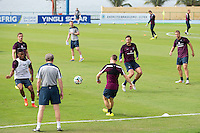 England manager Roy Hodgson watches Raheem Sterling and his team during training