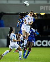 HOUSTON, TX - JANUARY 31: Chelsea Surpris #3 of Haiti and Maria Salas #17 of Costa Rica go to head the ball during a game between Haiti and Costa Rica at BBVA Stadium on January 31, 2020 in Houston, Texas.