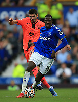 25th September 2021; Goodison Park, Liverpool, England; Premier League football, Everton versus Norwich; Abdoulaye Doucoure of Everton is tripped by Pierre Lees-Melou of Norwich City