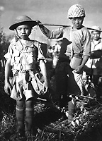 December 5, 1944. - This Chinese soldier, age 10, with heavy pack, is a member of a Chinese division which is boarding planes at the North Airstrip, Myitkyina, Burma, bound for China. December 5, 1944. Henry Allen. (Army)