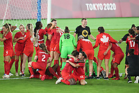 YOKOHAMA, JAPAN - AUGUST 6: Canada players including Kadeisha Buchanan #3 and Christine Sinclair #12 of Canada celebrate winning the gold medal during a game between Canada and Sweden at International Stadium Yokohama on August 6, 2021 in Yokohama, Japan.