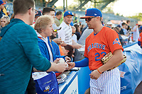 New York Mets Brandon Nimmo (23), on rehab assignment with the Syracuse Mets, signs autographs before a game against the Charlotte Knights on June 11, 2019 at NBT Bank Stadium in Syracuse, New York.  (Mike Janes/Four Seam Images)