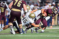 Texas State quarterback Tyler Jones (2) is brought down by Navy defensive end Paul Quessenberry (45) during second half of NCAA Football game, Saturday, September 13, 2014 in San Marcos, Tex. Navy defeated Texas State 35-21.(Mo Khursheed/TFV Media via AP Images)