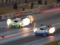 Jul 21, 2018; Morrison, CO, USA; NHRA funny car driver Matt Hagan (right) races alongside Jonnie Lindberg during qualifying for the Mile High Nationals at Bandimere Speedway. Mandatory Credit: Mark J. Rebilas-USA TODAY Sports