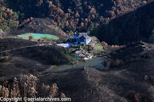 Mountain home surrounded by defensible space survives the Atlas Fire, Napa County, California, northern California wildfires, 2017.