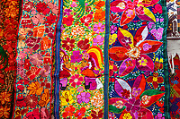 Chichicastenango, Guatemala.  Colorful Wall Hanging for Sale in the Market.