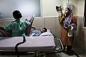 An woman gets emotional as her son lies on the stretcher waiting to be taken to the Operation Theatre of the Narayana Hrudayalaya in Bangalore, Karnataka, India. Photo: Sanjit Das/Panos