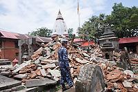 A police man guards at Goroknath Temple in Kathmandu, Nepal
