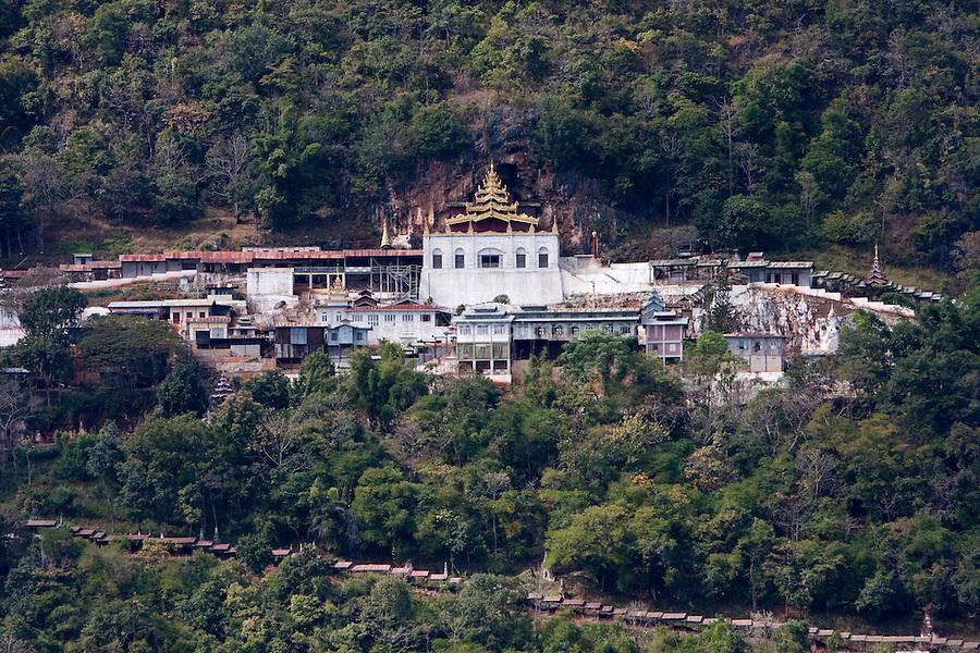 Myanmar, Burma.  Shwe Oo Min Pagoda and Entrance to Cave  on Hillside, Pindaya, Shan State.