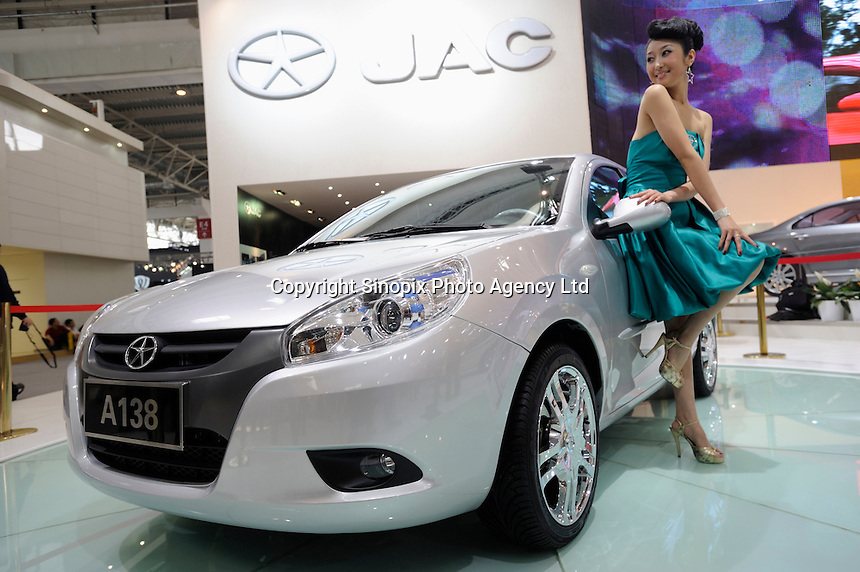 JAC A138 at the Auto China 2008 in Beijing. JAC is Anhui Jianghuai Automobile Co., Ltd. in Hefei, Anhui, China. The car show has attracted all the world's major auto markers. Vehicle production and sales both surged more than 20 percent to a record 8.8 million units in China last year. Analysts forecast that both China's auto output and sales will continue to expand at double-digit rates in 2008 to 10 million as the economy grows rapidly and the government tries to encourage people to spend money..24 Apr 2008