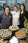 From left: Daya Myers-Hurt, Sharon Gofreed and Carol Rivas from State of Grace with the desserts at the Saks Fifth Avenue Key to the Cure Wednesday Oct. 26,2016.(Dave Rossman photo)