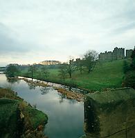 Alnwick Castle seen from the bridge over the River Alne