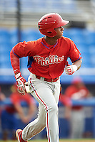 GCL Phillies center fielder Malvin Matos (39) runs to first during the first game of a doubleheader against the GCL Blue Jays on August 15, 2016 at Florida Auto Exchange Stadium in Dunedin, Florida.  GCL Phillies defeated the GCL Blue Jays 7-5 in a completion of a game started on July 30th.  (Mike Janes/Four Seam Images)
