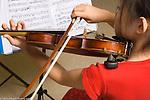 Girl playing violin, age 7
