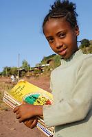 ETHIOPIA Lalibela, girl with school books / AETHIOPIEN Lalibela, Maedchen mit Schulbuechern