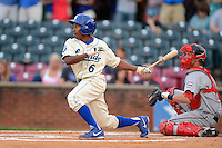 Lexington Legends outfielder Terrence Gore #6 at bat in front of catch Jordan Weems during a game against the Greenville Drive on April 18, 2013 at Whitaker Bank Ballpark in Lexington, Kentucky.  Lexington defeated Greenville 12-3.  (Mike Janes/Four Seam Images)