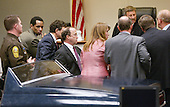 Sniper suspect John Allen Muhammad, second from left, looks back to see the model of the trunk of a Chevrolet Caprice during a bench conference in his trial in Virginia Beach Circuit Court in Virginia Beach, Virginia, November 6, 2003.<br /> Credit: Tracy Woodward - Pool via CNP