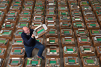 BNPS.co.uk (01202 558833)<br /> Pic: Zachary Culpin/BNPS<br /> <br /> Pictured: Adam Gascoigne of Graham Budd Auctions with collection <br /> <br /> An incredible collection of model football stadiums handmade by a soccer fan have sold for almost £19,000 after being found in a storage unit.<br /> <br /> Model-maker John Le Maitre created miniature versions of all 92 English Football League club grounds from the 1980s, as well as the old Wembley Stadium.<br /> <br /> They featured on a Blue Peter episode that year and are a throwback to a bygone age when football grounds with their banks of terraces looked very different to today's super stadiums.