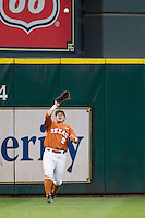 Texas Longhorns outfielder Mark Payton #2 makes a catch during the NCAA baseball game against the Houston Cougars on March 1, 2014 during the Houston College Classic at Minute Maid Park in Houston, Texas. The Longhorns defeated the Cougars 3-2. (Andrew Woolley/Four Seam Images)