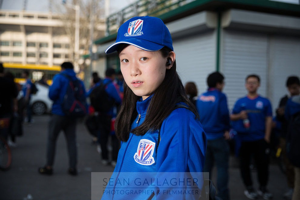 Wang Jiayi, 14, a fan of Chinese Super League football team Shanghai Shenhua wait outside the Worker's Stadium in Beijing before their team's game with Beijing Guo'an. 2nd April, 2017.