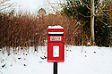 Red Post box in Beast fron The East Snow in Stonesfield in the Cotswolds