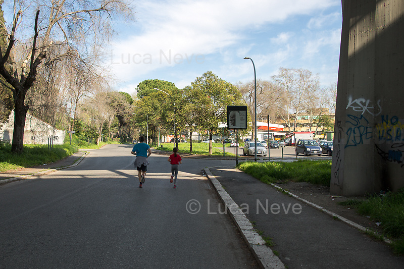Outdoor activities allowed in proximity of home.<br /> <br /> Rome, 18/03/2020. Rome's Olympic Village district under the Italian Government lockdown for the Outbreak of the Coronavirus SARS-CoV-2 - COVID-19. On the 22nd March, the Italian PM Giuseppe Conte signed a new Decree Law which suspends non-essential industry productions and contains the list of allowed working activities, which includes Pharmaceutical & food Industry, oil & gas extraction, clothes & fabric, tobacco, transports, postal & banking services (timetables & number of agencies reduced), delivery, security, hotels, communication & info services, architecture & engineer, IT manufacturers & shops, call centers, domestic personnel (1.).<br /> Updates: Italy: 22.03.20, 6:00PM: 46.638 positive cases; 7.024 recovered; 5.476 died.<br /> <br /> The Rome's Olympic Village (1957-1960) was designed by: V. Cafiero, A. Libera, A. Luccichenti, V. Monaco, L. Moretti. «Built to host the approximately 8,000 athletes involved in the 1960 Olympic Games, Rome's Olympic Village is a residential complex located between Via Flaminia, the slopes of Villa Glori and Monti Parioli. It was converted into public housing [6500 inhabitants, ndr] at the end of the sporting event. The intervention is an example of organic settlement, characterized by a strong formal homogeneity, consistent with the Modern Movement's principles of urbanism. The different architectural structures are made uniform by the use of some common elements: the pilotis, ribbon windows, concrete stringcourses, and yellow brick curtain covering. At the center of the neighborhood, the Corso Francia viaduct - a road bridge about one kilometer long - was built by Pier Luigi Nervi […]» (2.).<br /> <br /> Info about COVID-19 in Italy: http://bit.do/fzRVu (ITA) - http://bit.do/fzRV5 (ENG)<br /> 1. March 22nd Decree Law http://bit.do/fFwJn (ITA)<br /> 2. (Atlantearchitetture.beniculturali.it MiBACT, ITA - ENG) http://bit.do/fFw3H<br /> 12.03.20 Rome's Lockdown  http: