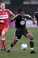 DC United  forward Luciano Emilio (11) dribbles the ball while covered by Chicago Fire defender Tim Ward (5)  ,Chicago Fire tied DC United 1-1 at  RFK Stadium, Saturday March 28, 2009.