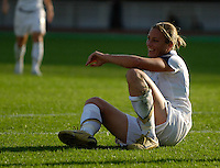 U.S. forward (20) Abby Wambach is able to smile despite being pushed to the ground. The United States (USA) defeated Sweden (SWE) 2-0 during a FIFA Women's World Cup China 2007 opening round Group B match at Chengdu Sports Center Stadium, Chengdu, China, on September 14, 2007.