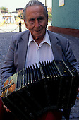 Buenos Aires, Argentina. Old musician playing the accordion in La Boca district.