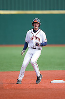 Pavin Smith (10) of the Virginia Cavaliers stops at second base after hitting a double against the Hartford Hawks at The Ripken Experience on February 27, 2015 in Myrtle Beach, South Carolina.  The Cavaliers defeated the Hawks 5-1.  (Brian Westerholt/Four Seam Images)