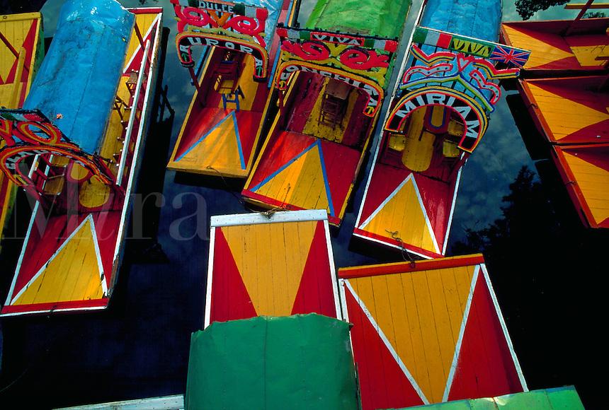 Overhead shot of colorful excursion boats in Xochimilco, Mexico City, Mexico
