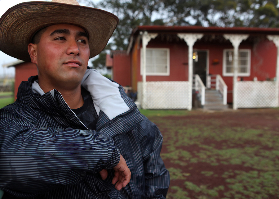 """Fourth generation cowboy, Jessie Ho'opai, is photographed outside the home he lives in on Parker Ranch in Waimea, Hawaii.  """"I was born and raised in this house on Parker Ranch and now me and my wife are raising our two kids in this same house.  I just love the way we were raised and the way we respect ourselves and the land and the animals that we raise here.  There's not too many cowboys left and I'm glad that I still have the privelege to be one or work as one,"""" says Ho'opai.  Ho'opai is one of only 12 remaining cowboys left on Parker Ranch which is one of the oldest and largest cattle ranches in the United States."""