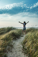 Woman rejuvenated by the coastal outdoors of Cape Cod, Massachusetts, USA