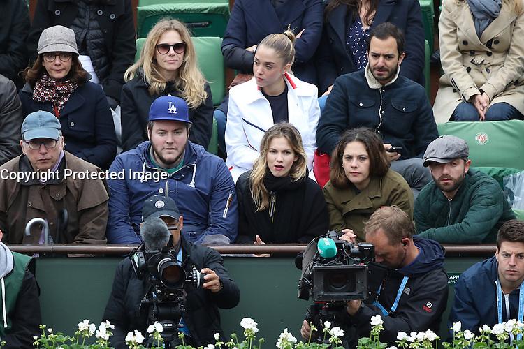 Valerie Karsenti, Pascale Arbillot, Alice Isaaz and Benjamin Bouhana, Alyson Paradis and boyfriend Guillaume Gouix watching tennis during Roland Garros tennis open 2016 in Paris on June 02 2016.