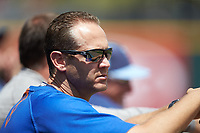 Durham Bulls strength coach Bryan King watches the action from the dugout during the game against the Charlotte Knights at BB&T BallPark on May 27, 2019 in Charlotte, North Carolina. The Bulls defeated the Knights 10-0. (Brian Westerholt/Four Seam Images)