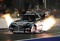 Sept. 16, 2011; Concord, NC, USA: NHRA funny car driver Matt Hagan races downtrack during qualifying for the O'Reilly Auto Parts Nationals at zMax Dragway. On the run Hagan would become the first funny car driver to run below the four second barrier as he clocked a 3.995 elapsed time. Mandatory Credit: Mark J. Rebilas-US PRESSWIRE