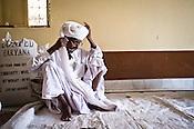 75-year-old Manganiyar artist and a Padmashree awardee, Saqar Khan ties his turban while getting ready for a portrait inside his house in Hamira village of Jaiselmer district in Rajasthan, India. Photo: Sanjit Das/Panos
